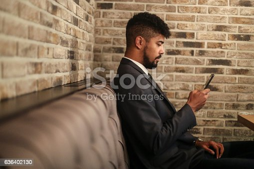 istock Man using his phone 636402130