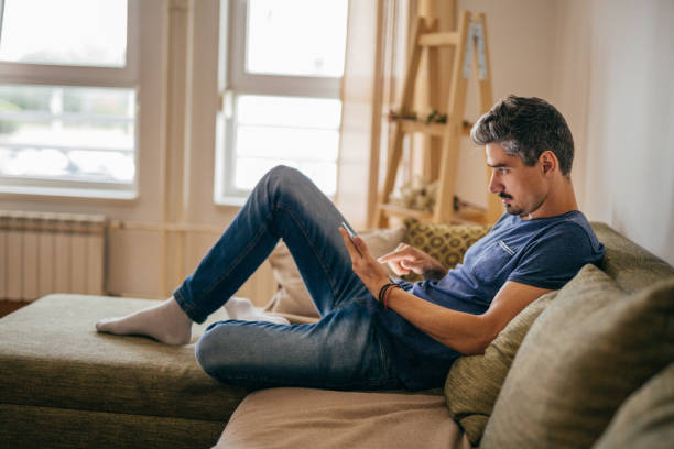 man using his smartphone - milan2099 stock photos and pictures
