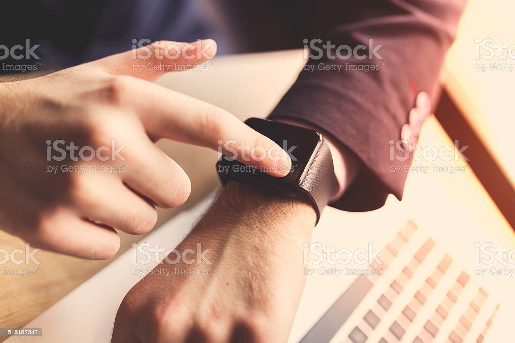Man using his smartwatch stock photo