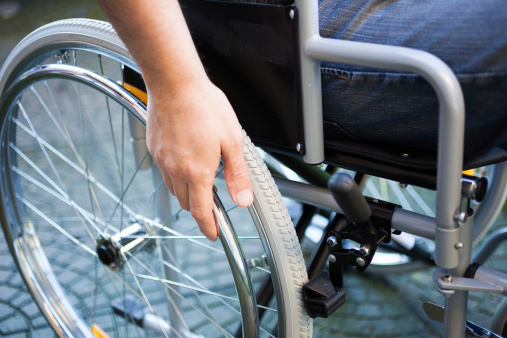 Man Using His Wheelchair Stock Photo - Download Image Now
