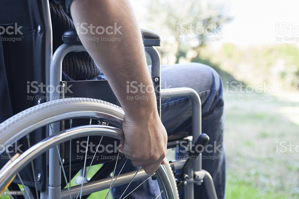 Man using his wheelchair 免版稅 stock photo
