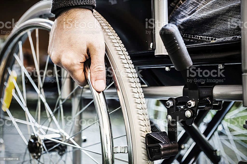 Man using his wheelchair stock photo