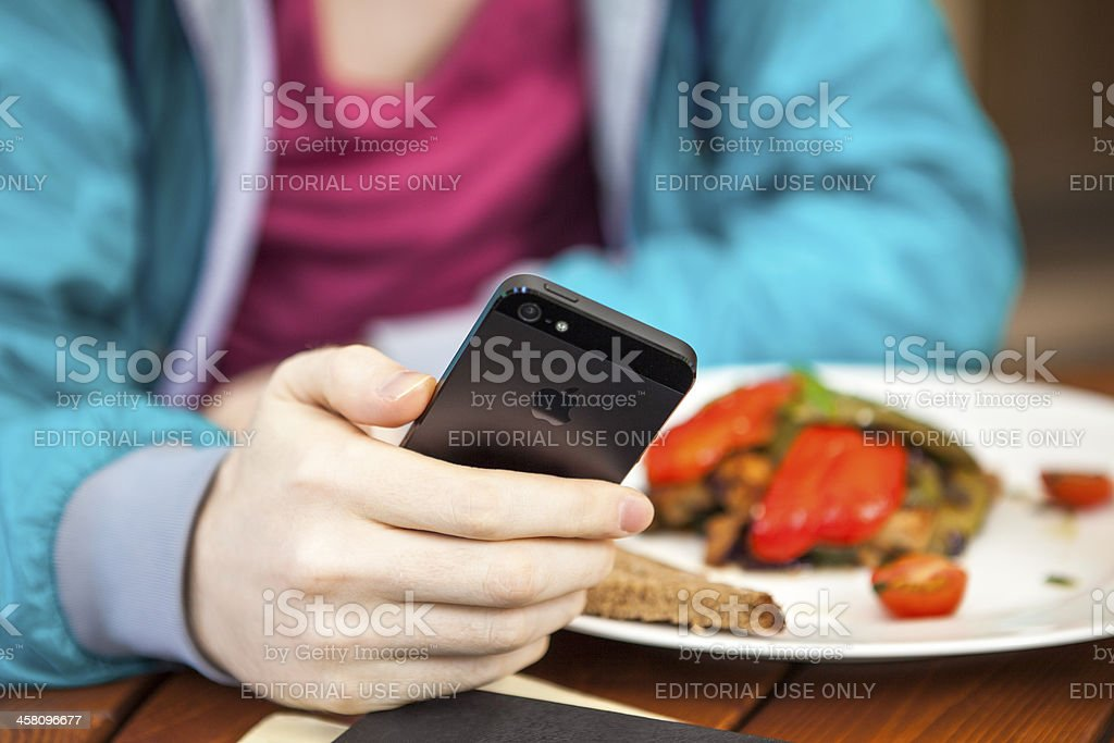 Man using iPhone 5 royalty-free stock photo