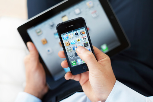 Man Using Iphone4 And Ipad Stock Photo - Download Image Now