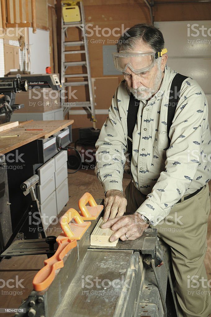 Man using joiner in workshop stock photo