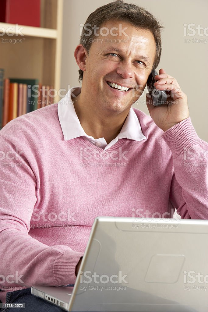 Man Using Laptop And Phone royalty-free stock photo