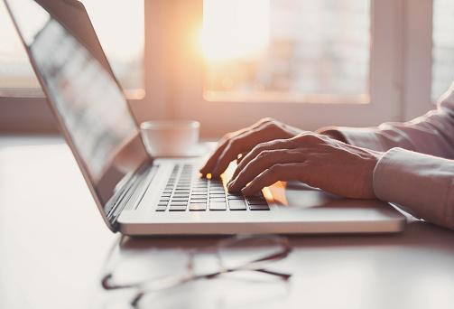Man Using Laptop Computer Stock Photo - Download Image Now