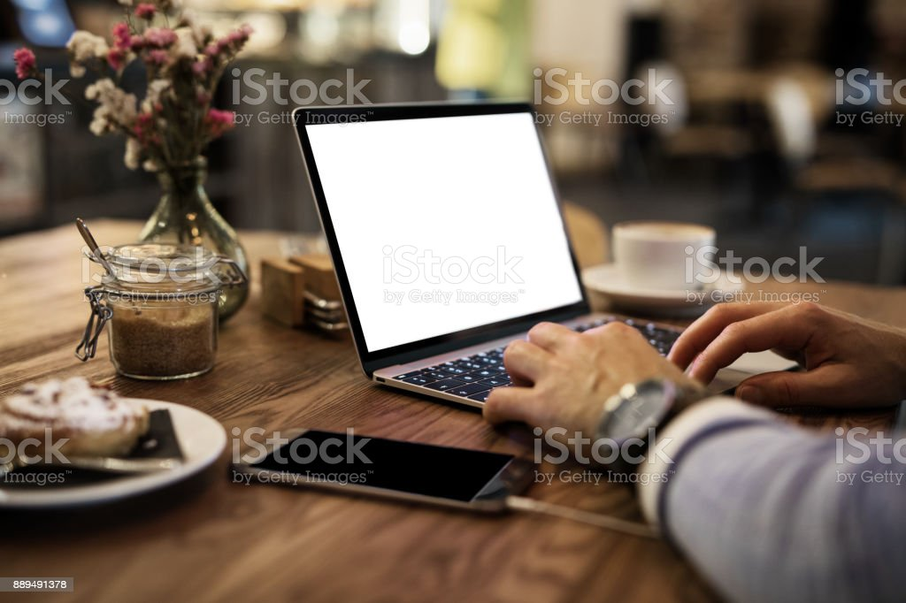 Man using laptop in cafe stock photo