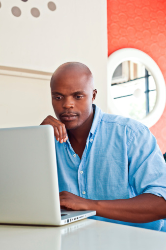 Man Using Laptop Stock Photo - Download Image Now