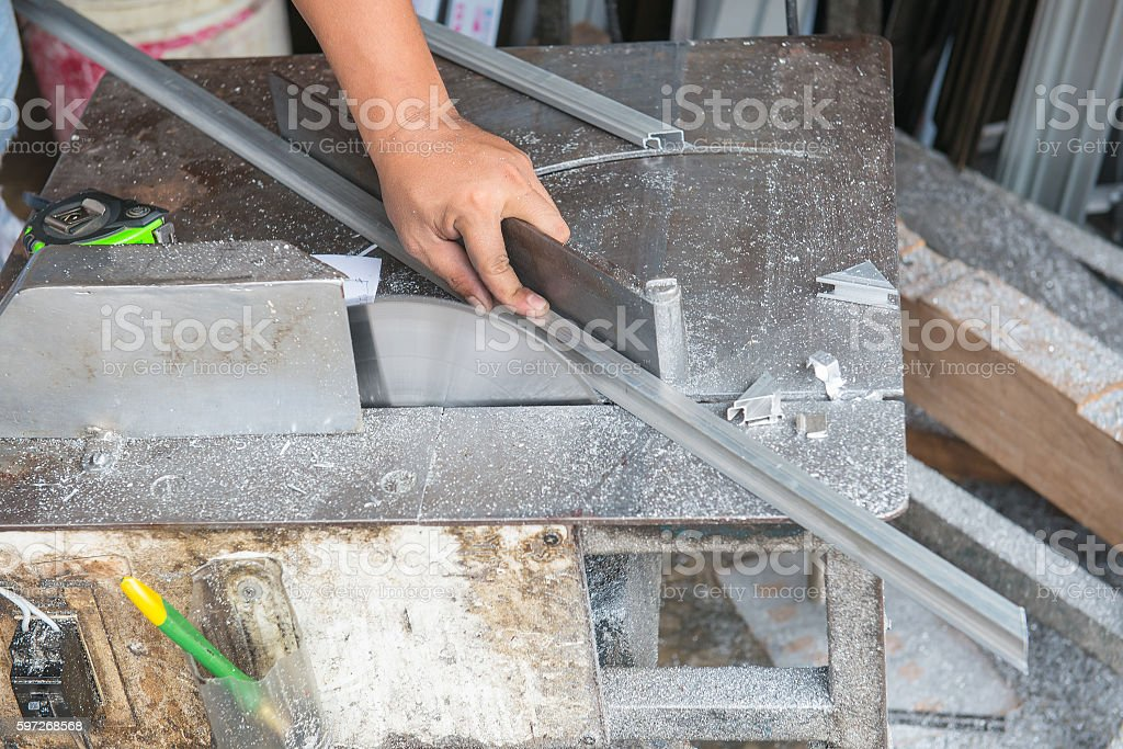 man using machine to cut aluminium Lizenzfreies stock-foto