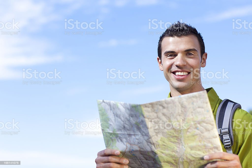 Man using map royalty-free stock photo