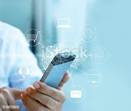 istock Man using mobile payment, holding circle global 515472824
