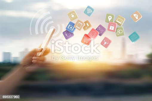 istock Man using mobile payments for online shopping and icon customer network connection on speed motion blur background 695337960