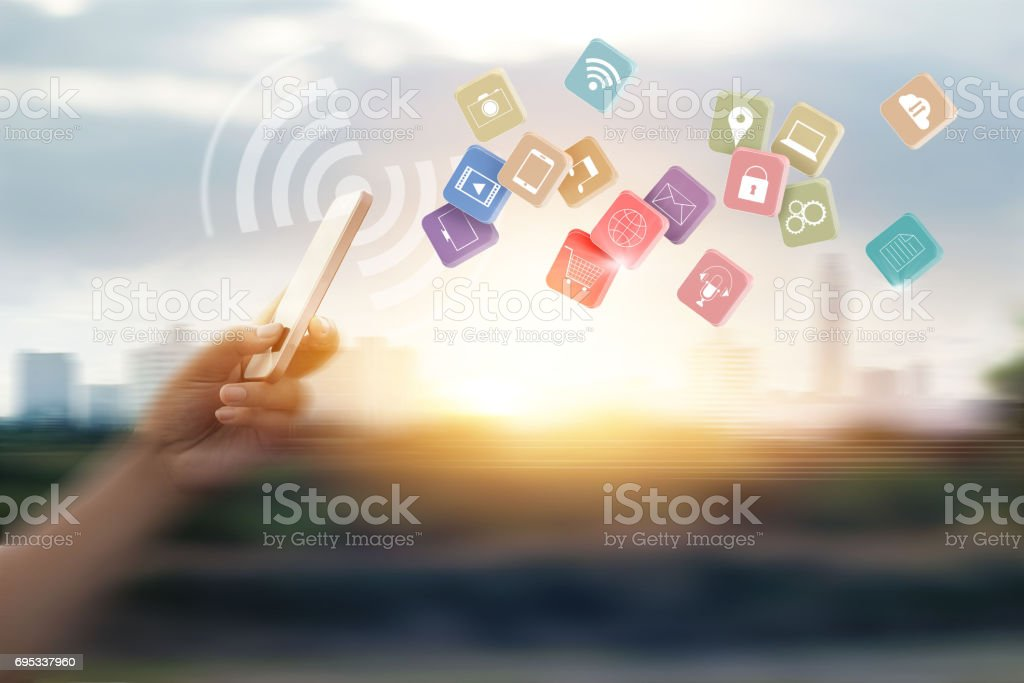 Man using mobile payments for online shopping and icon customer network connection on speed motion blur background stock photo