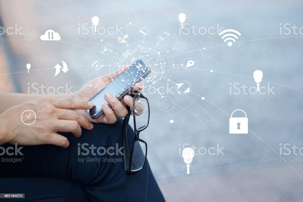 Man using mobile payments for online shopping and icon customer network connection on screen, m-banking and omni channel stock photo