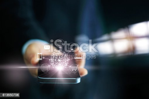 istock Man using mobile payments, holding circle global and icon customer 613550706