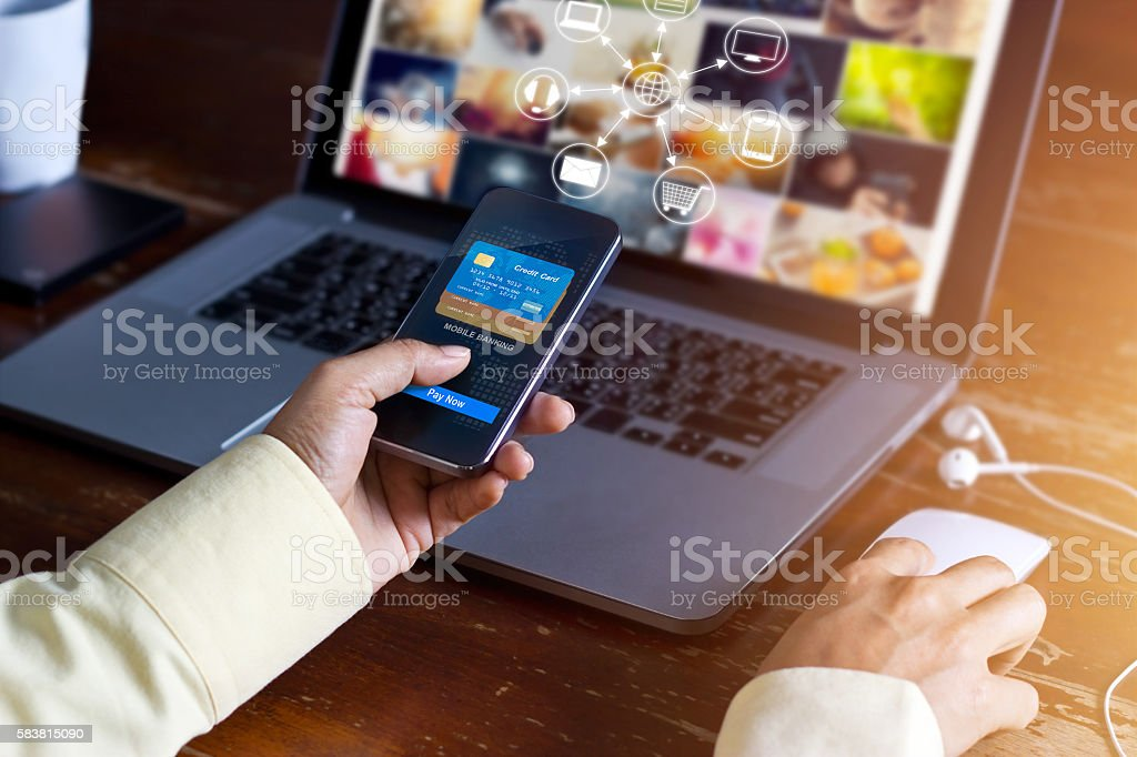 Man using mobile payments online shopping and icon customer network - foto de acervo