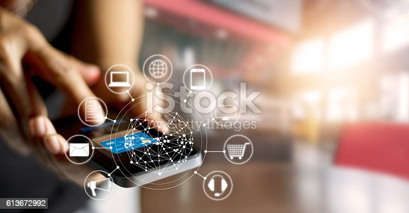 istock Man using mobile payments online shopping and icon customer network 613672992