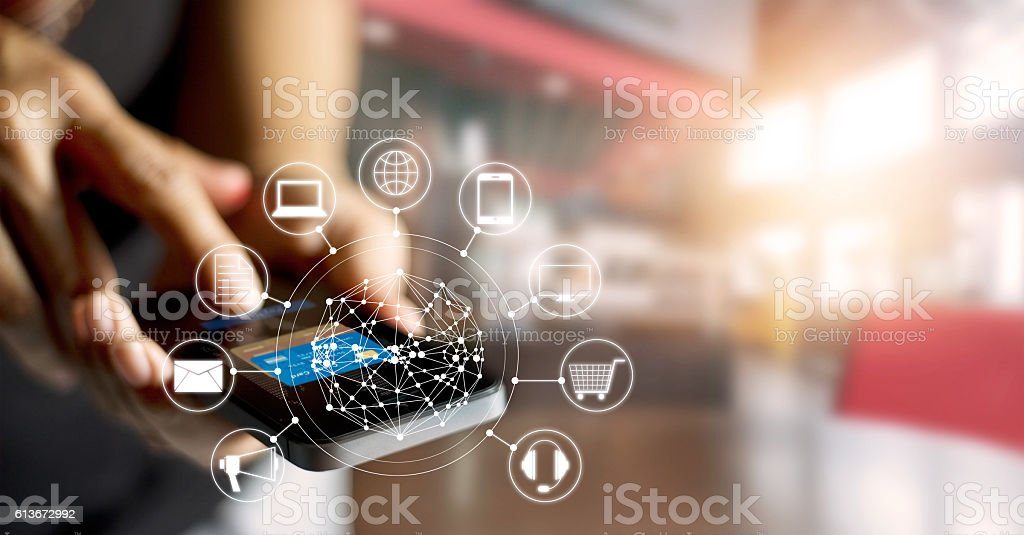 Man using mobile payments online shopping and icon customer network bildbanksfoto
