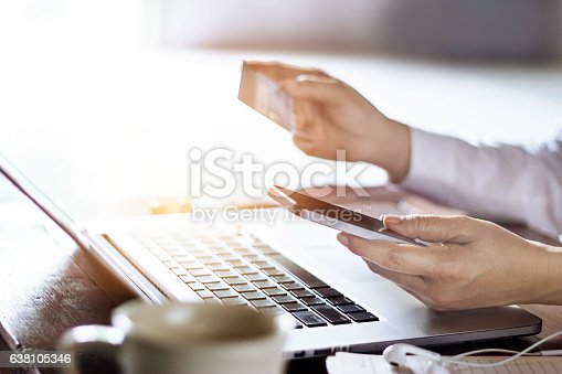 istock Man using mobile payments with credit card for online shopping 638105346