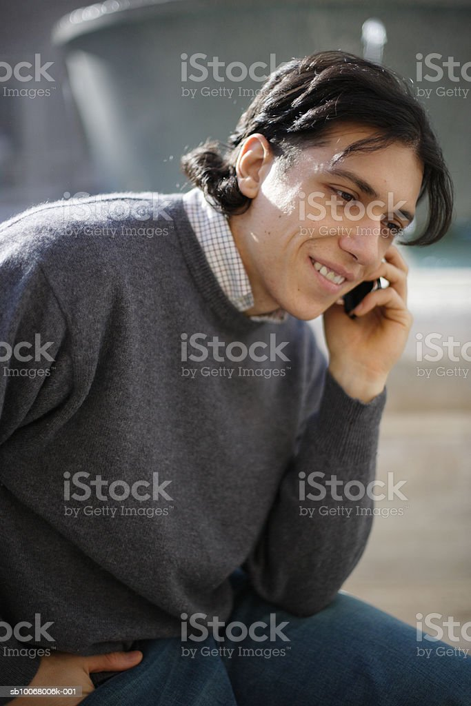 Man using mobile phone outdoors royalty-free stock photo