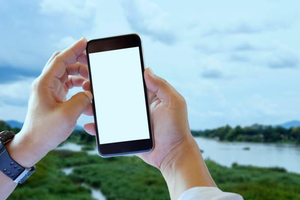 man using mobile phone. - phone, travelling, copy space imagens e fotografias de stock