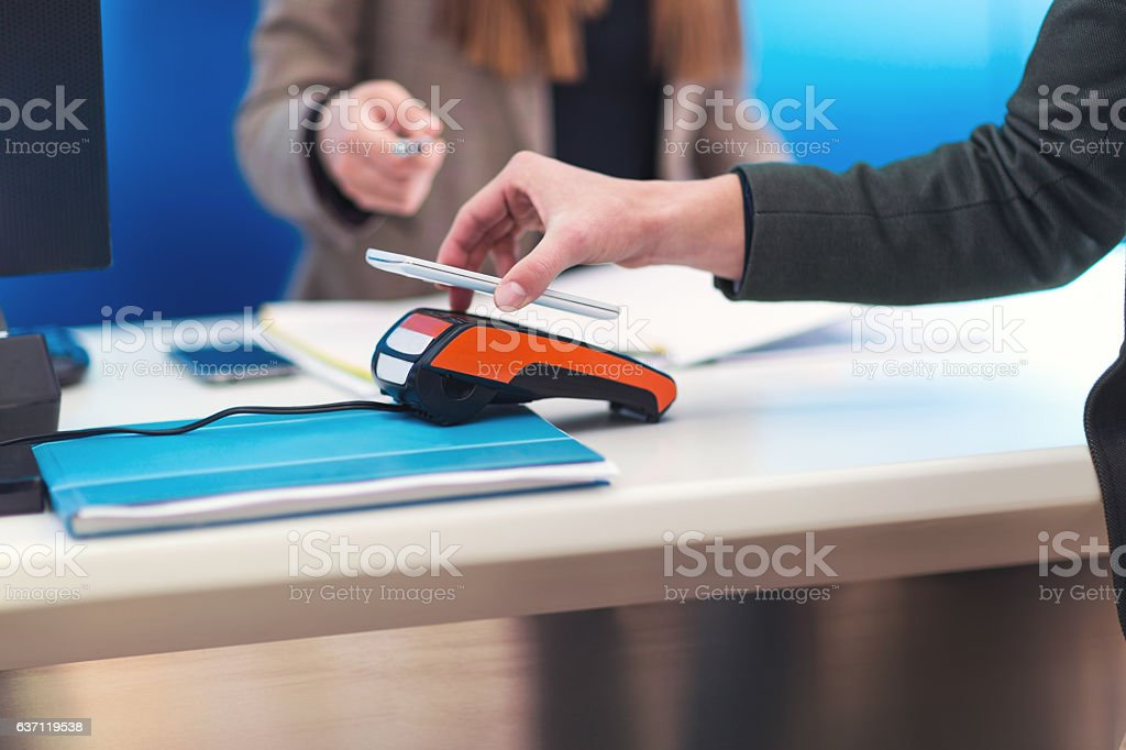 Man using mobile phone to pay stock photo