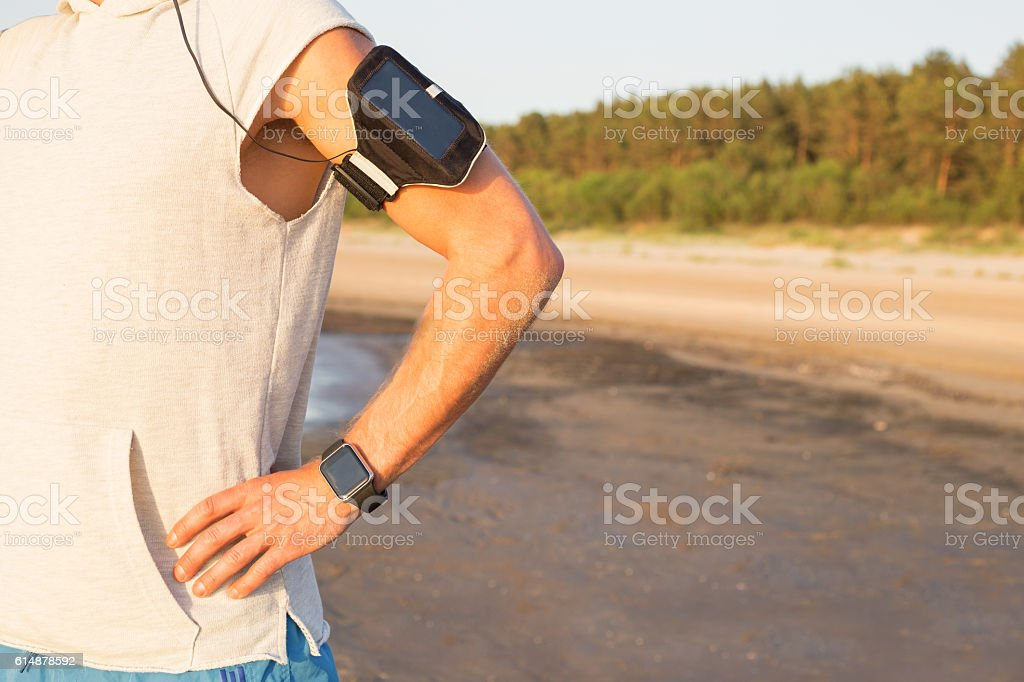 Man using music player while working out stock photo