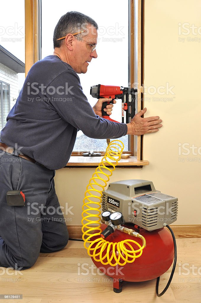 Man using nail gun royalty-free stock photo