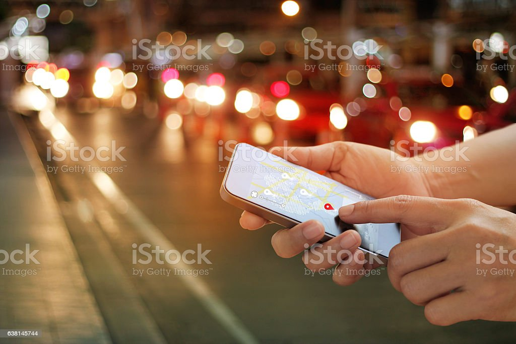man using navigation app on the smartphone on street stock photo