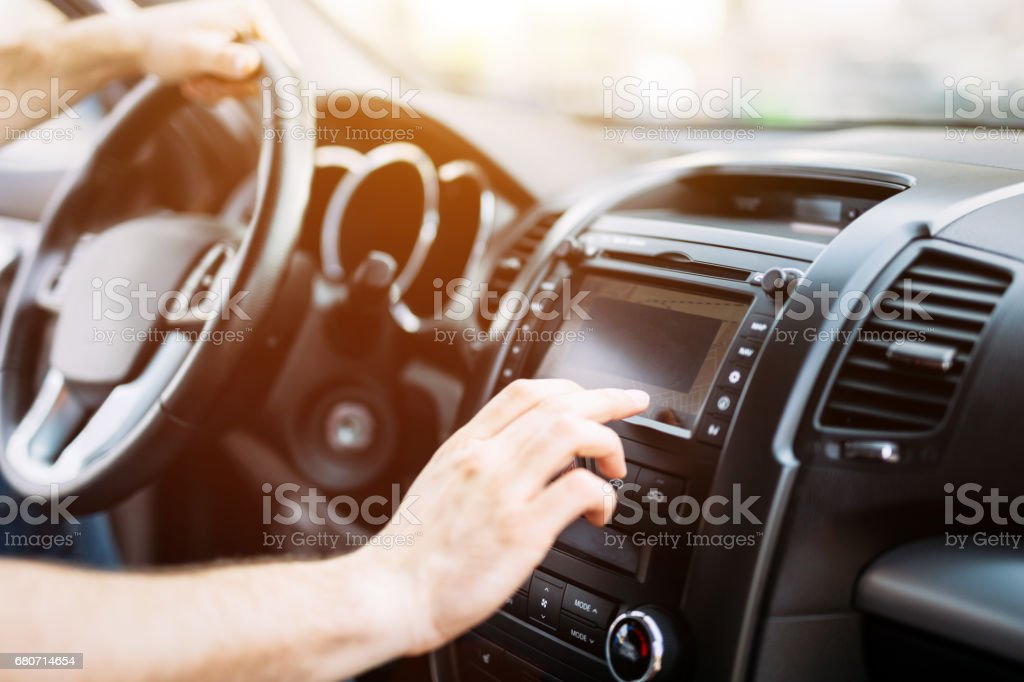 Man using navigation system while driving car stock photo