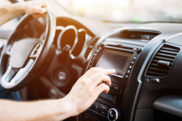 man using navigation system while driving car - dashboard vehicle part stock photos and pictures