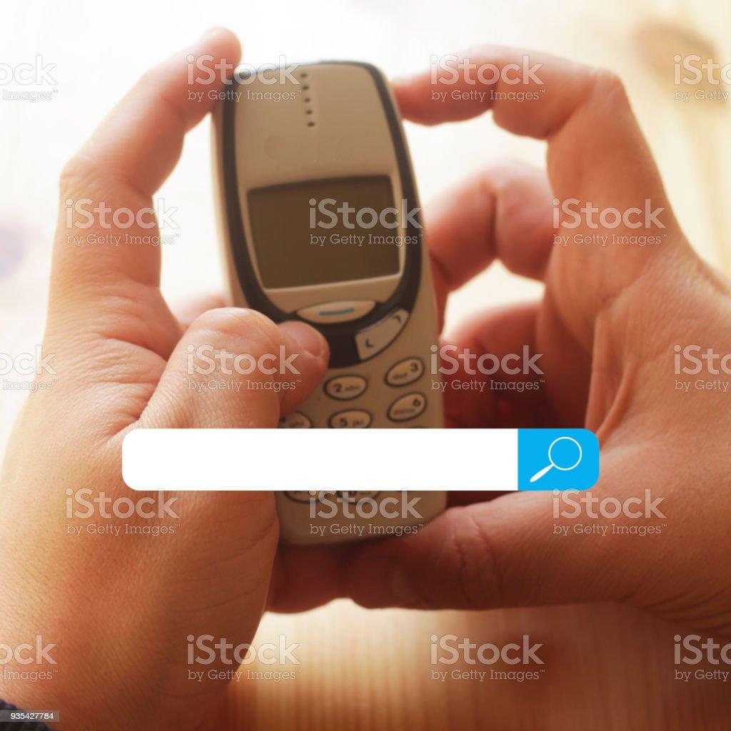 man using old phone stock photo