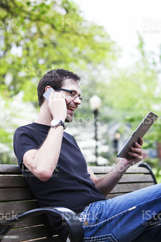 Man Using Phone and Tablet royalty-free stock photo
