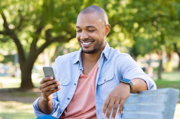 Man using phone outdoor stock photo