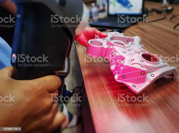 Man Using Portable Scanner To Import 3d Cad Model Of Complex Mechanical Part Into Computer Stock Photo - Download Image Now