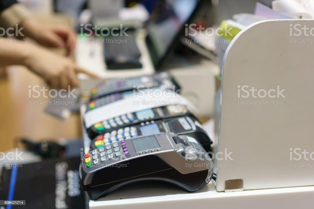 Man using pos terminal at the shop stock photo