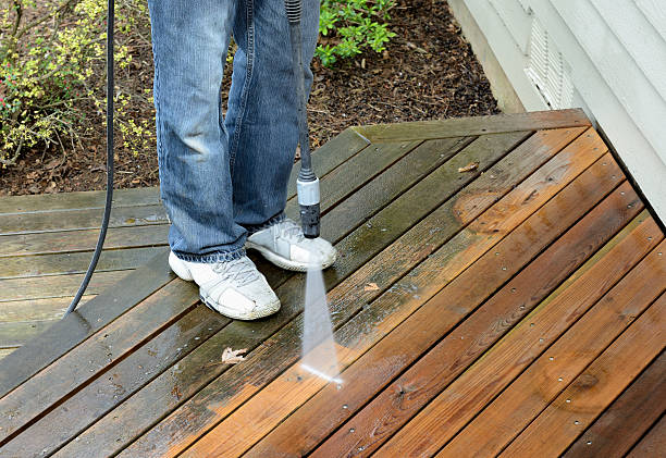 man using power washer - high pressure cleaning stock photos and pictures