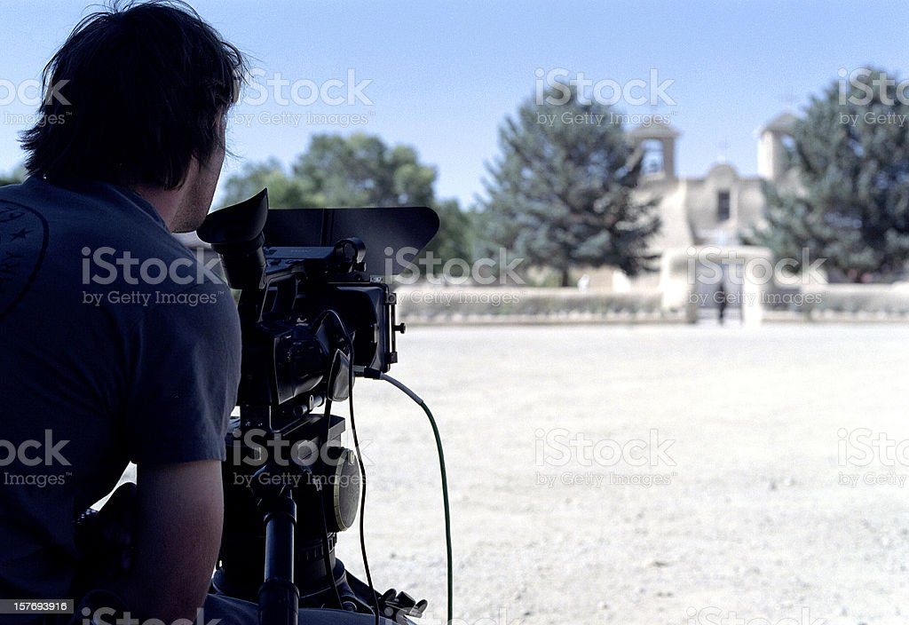 Man using professional camera to shoot the landscape royalty-free stock photo