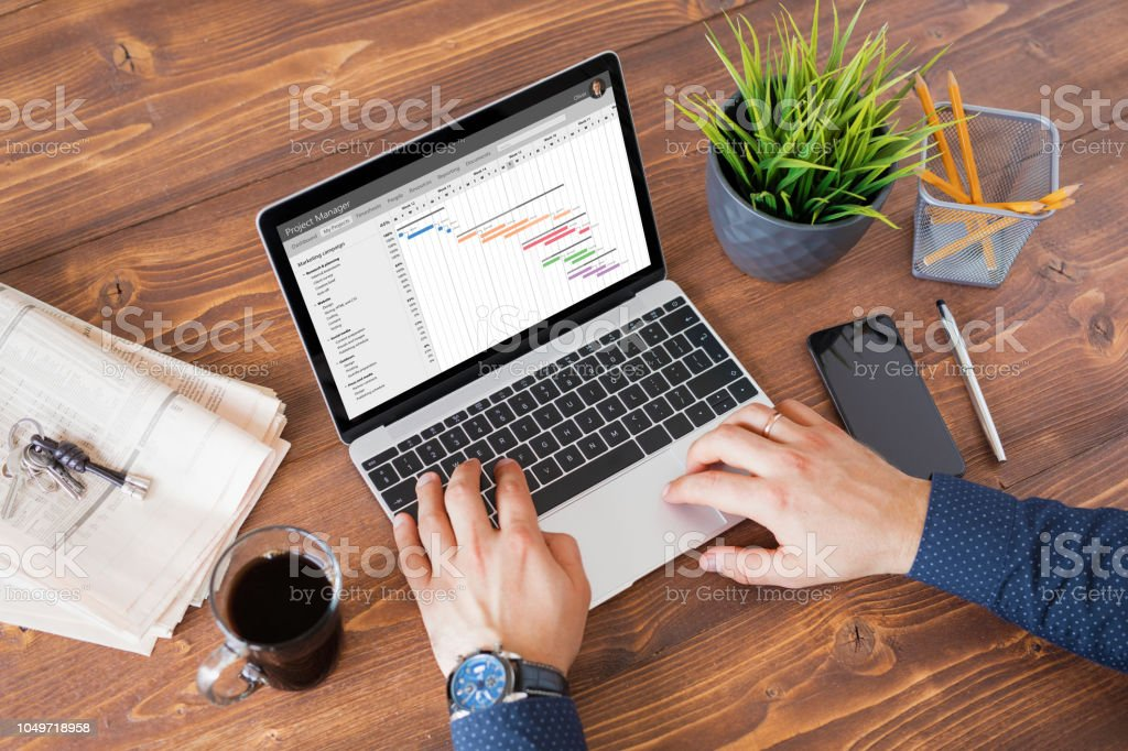 Man using project management software at work stock photo