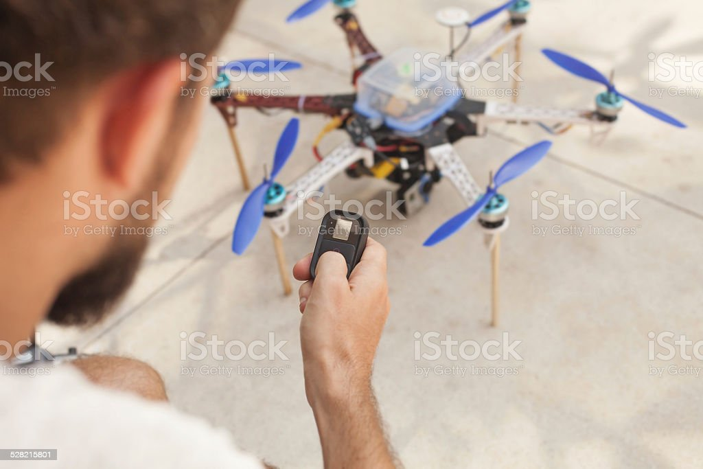 Man using remote control device stock photo