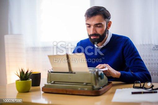 Man using retro typewriter