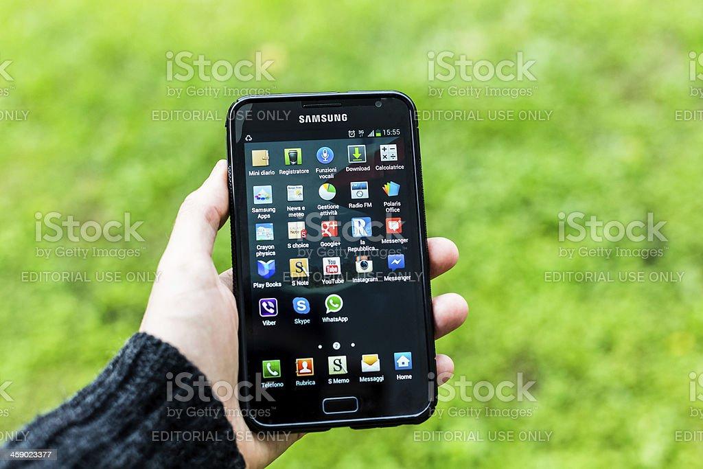 Man using Samsung Galaxy Note stock photo