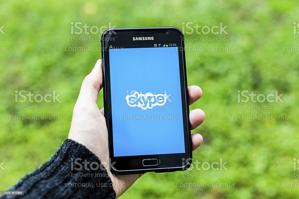 Man using Samsung Galaxy Note with Skype application stock photo