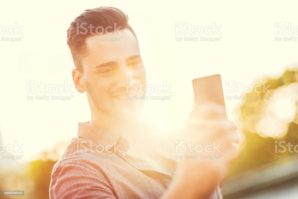 Man using smart phone at sunset. royalty-free stock photo