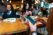 Man using smart phone during business lunch