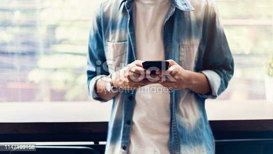 istock Man using smartphone, During leisure time. The concept of using the phone is essential in everyday life. 1147199158