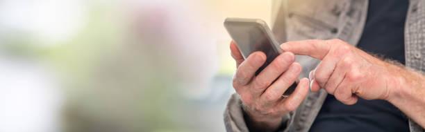 Man using smartphone, light effect stock photo