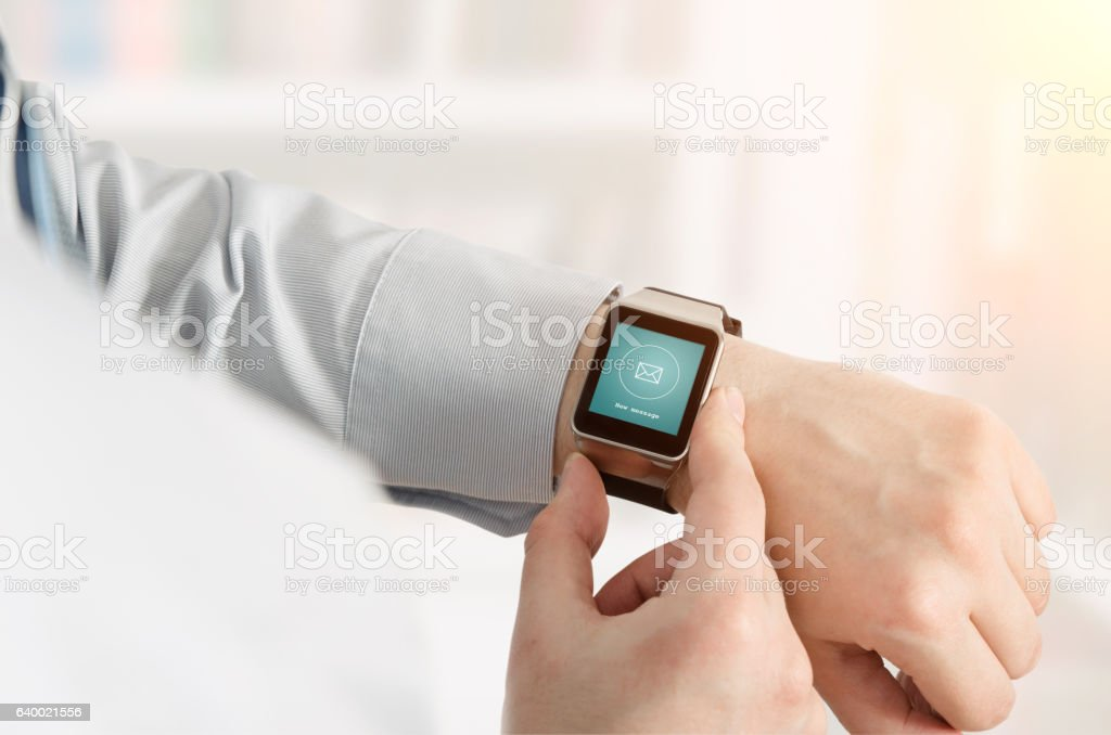 Man using smartwatch with e-mail notifier stock photo