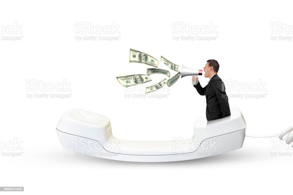 Man using speaker yelling with dollar bills spraying out stock photo